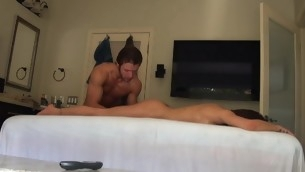 Massuer is bracing honey's cunt with vibrator after rub down