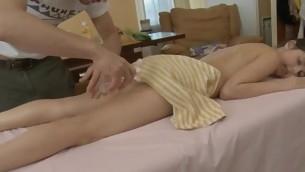 Youthful masseur is acquiring a hard boner from massaging hottie